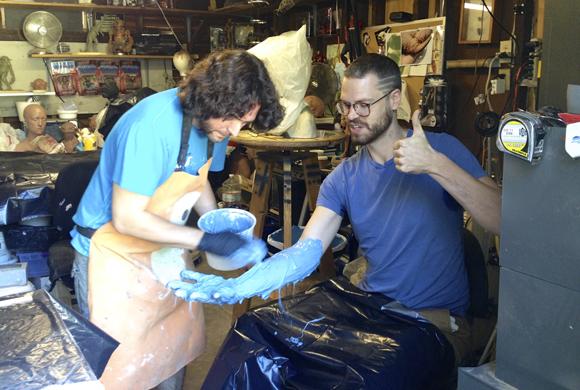 Mario Torres Jr. molding Kirkland's hand
